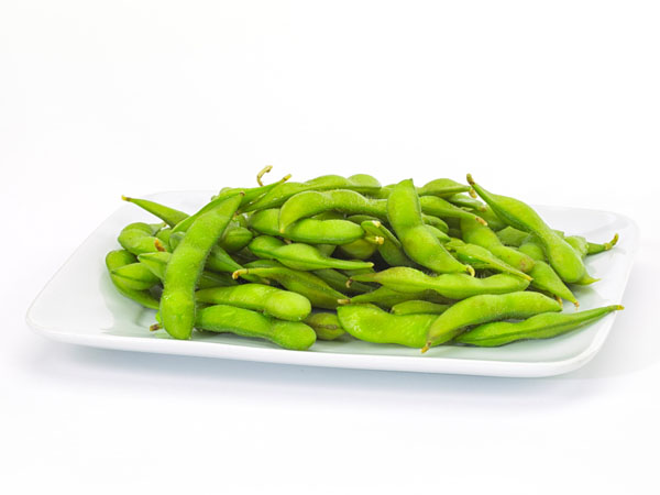 Edamame soy beans in a white ceramic dish
